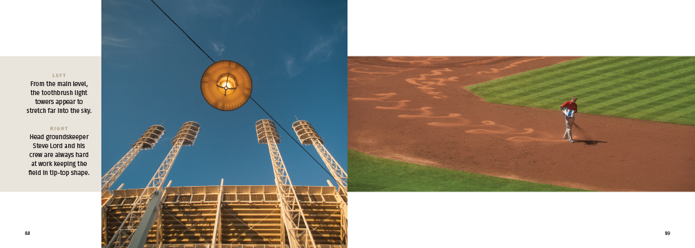 light towers and a groundskeeper at work